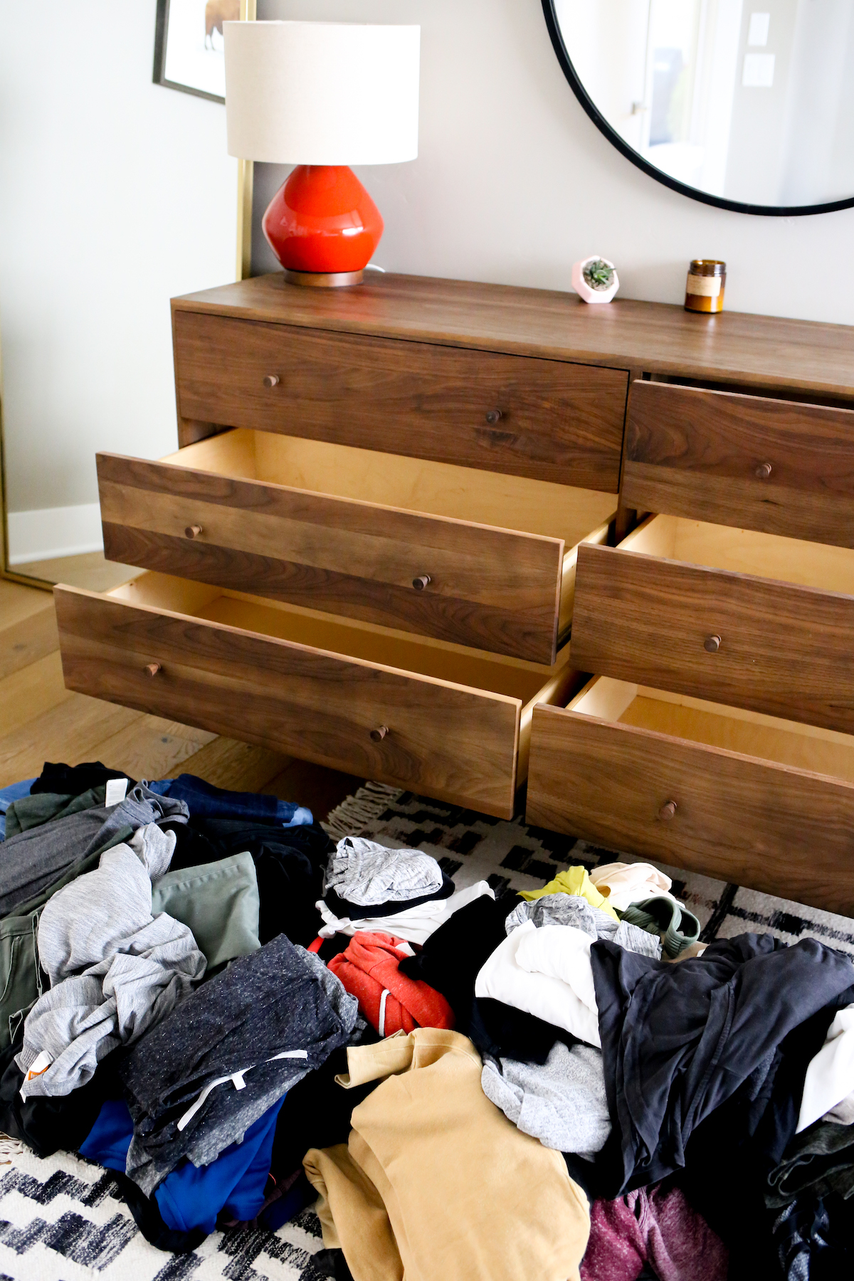 Dresser with clothing for capsule wardrobe