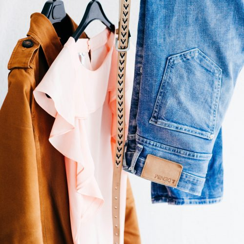 capsule wardrobe simple womens clothes hanging on rack