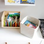 two bins of organized kids books