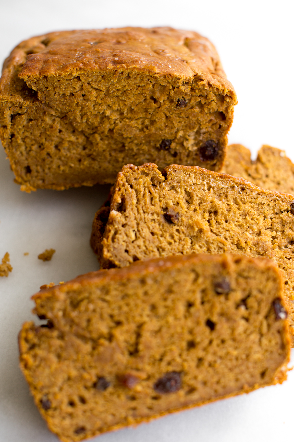 Closeup of a sliced pumpkin banana bread