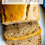 overhead photo of a loaf of healthy banana bread with walnuts with title text overlay