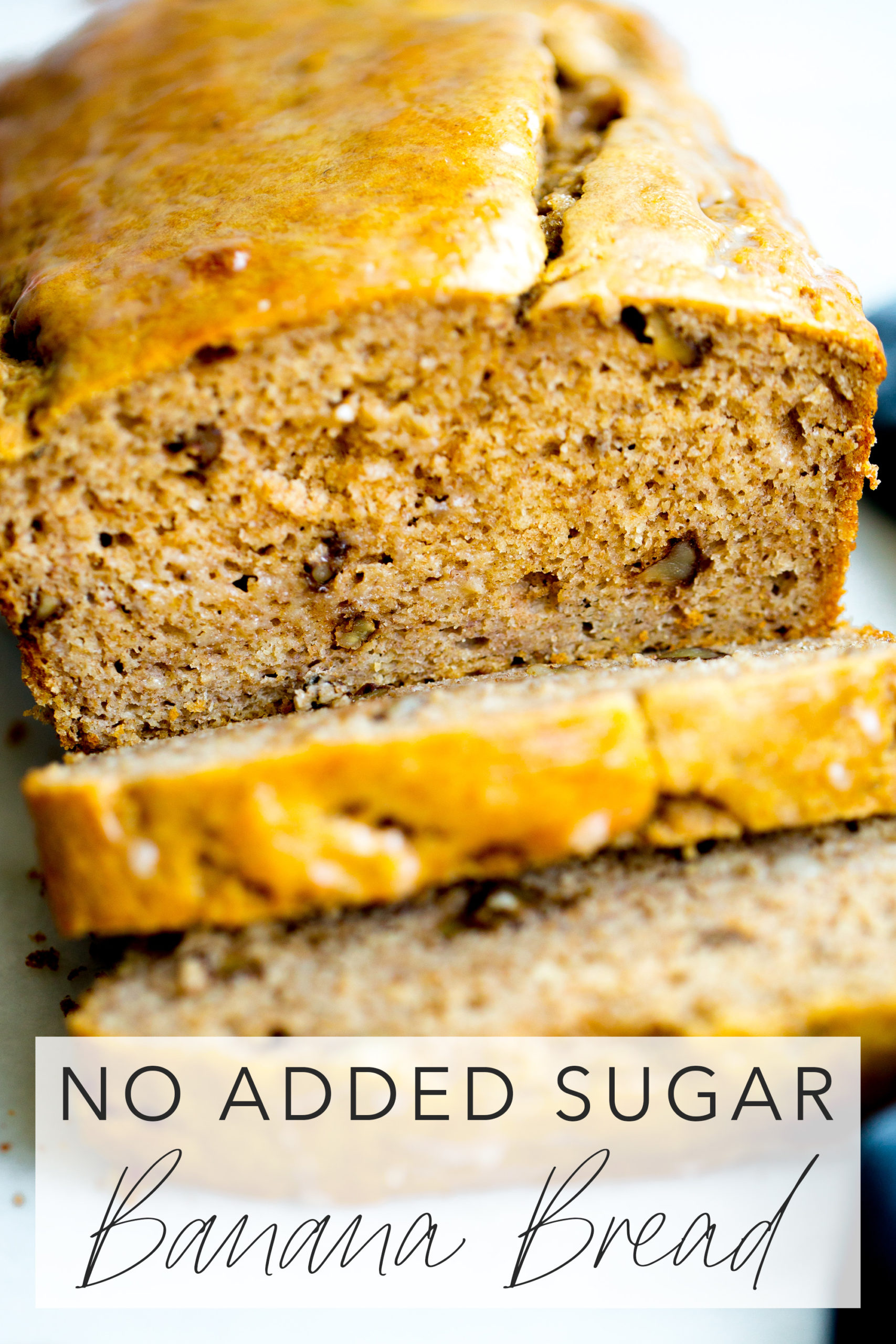 close up photo of a loaf of healthy banana bread with walnuts with title text overlay