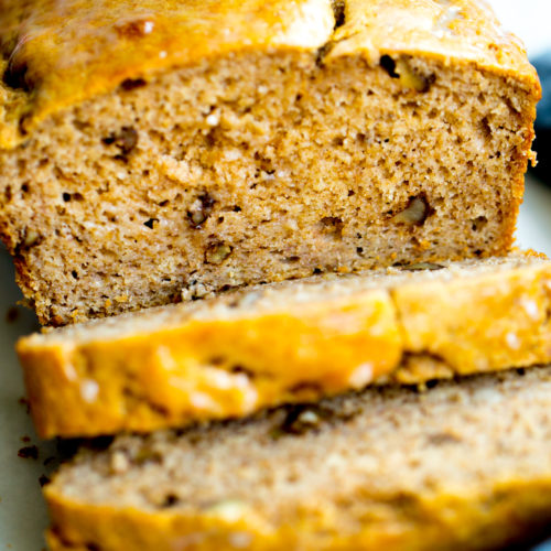 close up photo of a loaf of healthy no added sugar banana bread with two slices cut