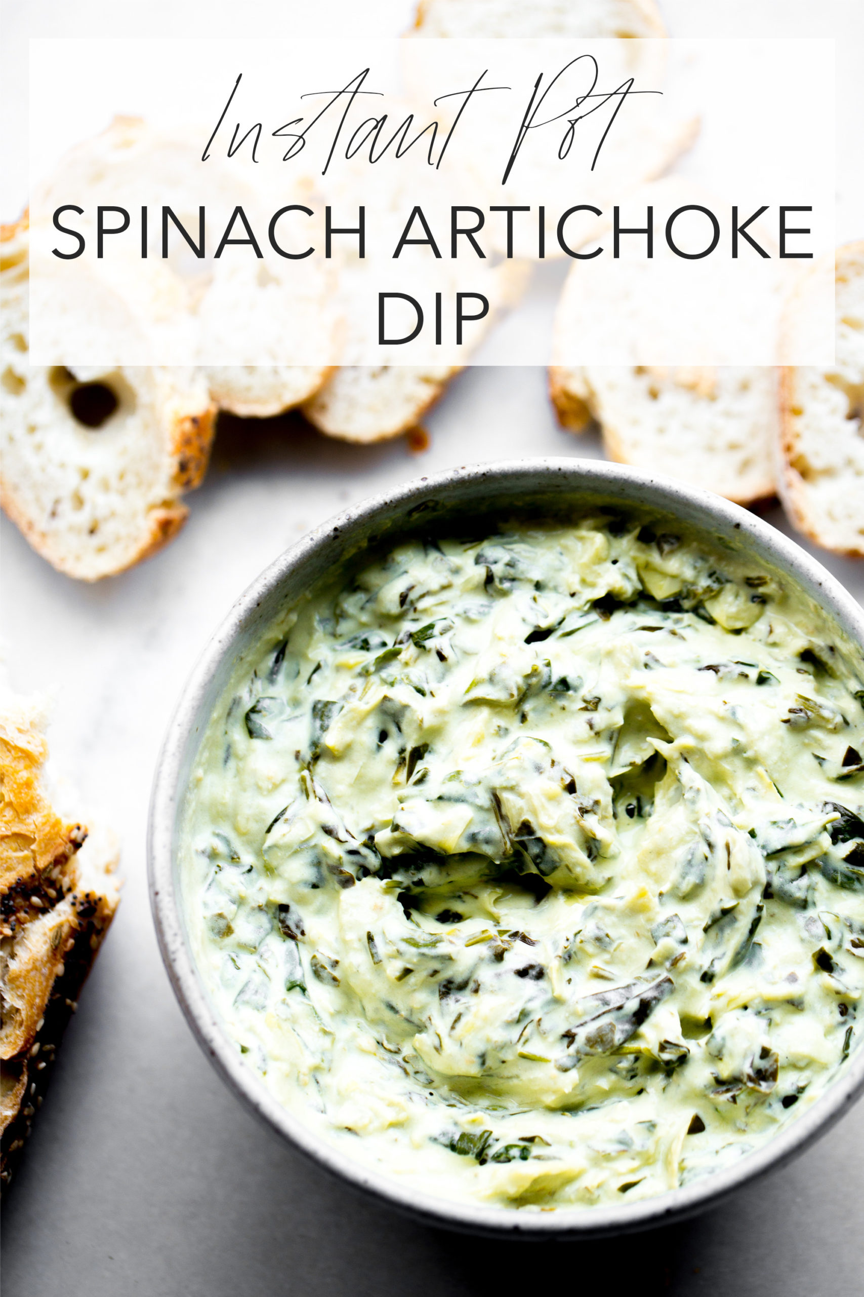 overhead photo of creamy instant pot spinach artichoke dip with sliced baguette on white marble background with title text