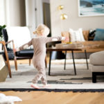 small girl dancing in modern living room
