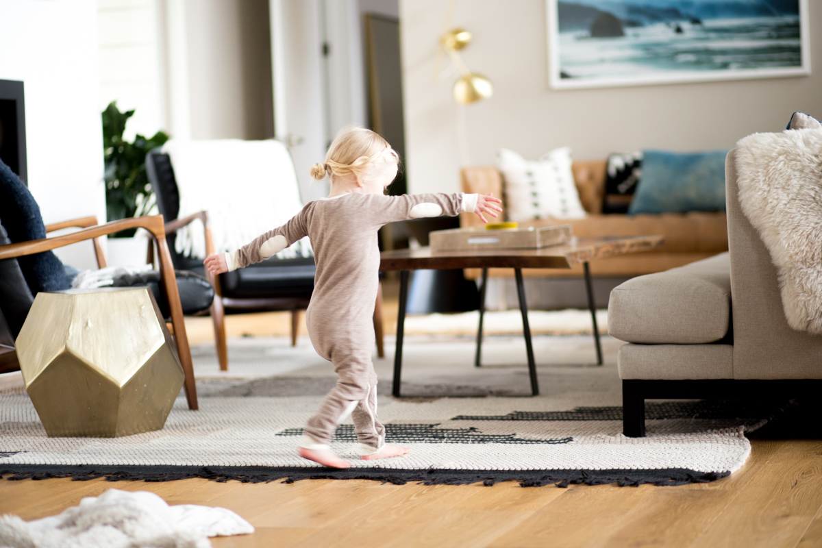 small girl dancing at home in pajamas