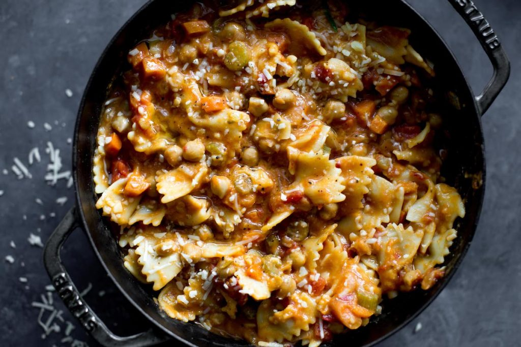 bowtie pasta with chickpeas in a dutch oven