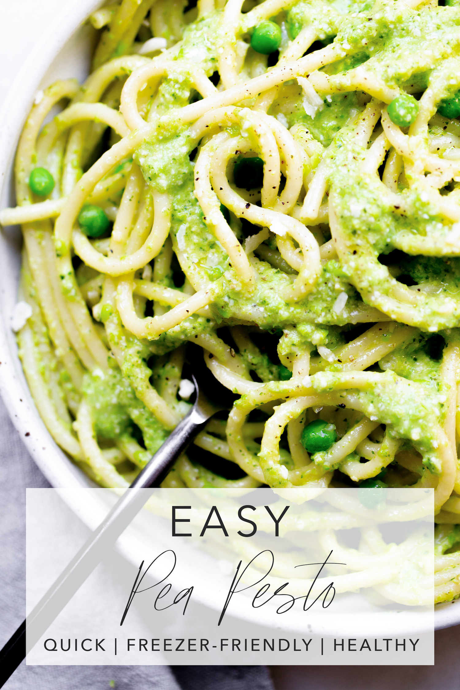 closeup of spaghetti pasta coated in pea pesto with title text overlay