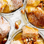 closeup overhead photo of french toast muffins in aluminum muffin tin with title text overlay